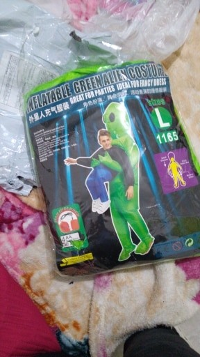 Green Alien Carrying Human Costume photo review